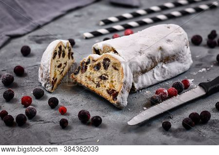 Slice Of Traditional German Christmas Season Sweet Food Called 'stollen' Or 'christstollen', A Fruit