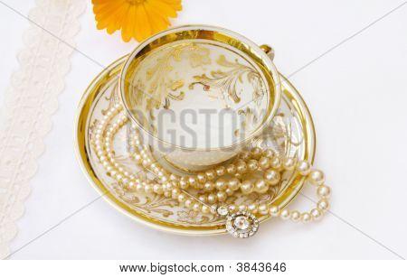 Vintage Golden Teacup With Flower