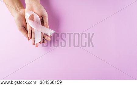 Hands Holding Pink Ribbons, Breast Cancer Awareness, Symbolic Bow Color Raising Awareness On Women's