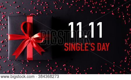 Online Shopping Of China, 11.11 Singles Day Sale Concept. Top View Of Black Christmas Boxes With Red