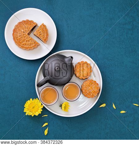 Moon Cake For Mid-autumn Festival, Delicious Beautiful Fresh Mooncake On A Plate Over Blue Backgroun