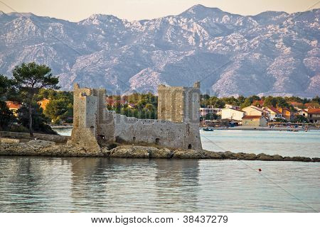 Island of Vir fortress ruins with Velebit mountain in background Dalmatia Croatia poster