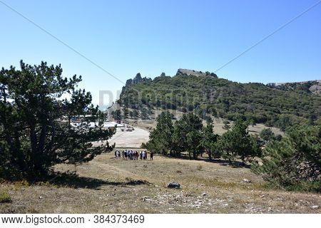 Yalta, Crimea - September, 9, 2007: A Group Of Tourists Admire The Landscape Of Mount Ai-petri