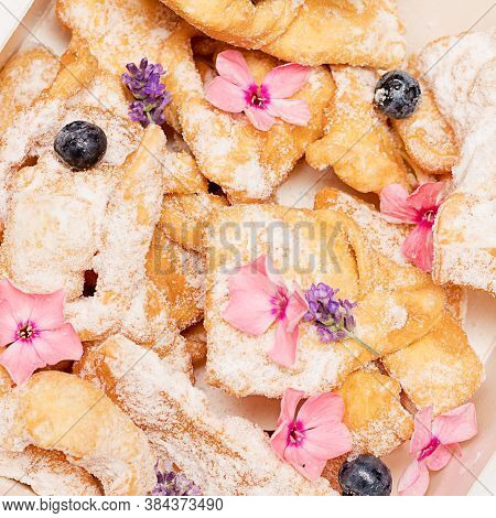 Crunchy Brittle Thin Straws Twiglets Cookies Sprinkled With Powdered Sugar Decorated With Flowers. H
