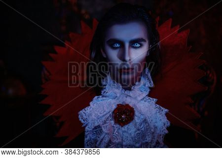 Portrait of an insidious vampire sneaking through the night in an old castle. Traditional vampire man. Halloween. Count Dracula.
