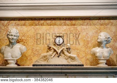 Budva, Montenegro - 07 August 2020: Vintage Watch Made Of White Marble With Statues Of Girls, Marble