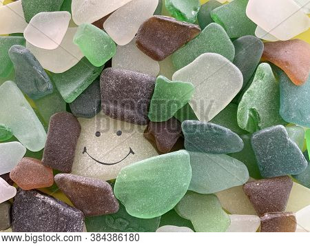 A Stone With A Painted Smile. On The Shore, One Stone Stands Out From The Others. There Is A Picture