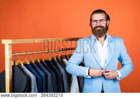 Always In Style. Style And People Concept. Handsome Man In Smart Casual Wear Looking At Suits And Ch