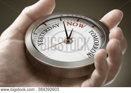Man Hand Holding A Conceptual Clock With The Words Yesterday, Now And Tomorrow. Concept Of Time Mana