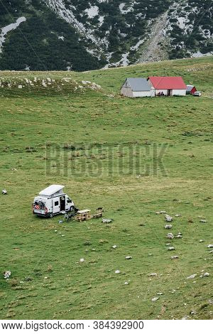 Tourists Set Up A Car Camp In The Mountains, On The Green Grass. Montenegro, Durmitor National Park.