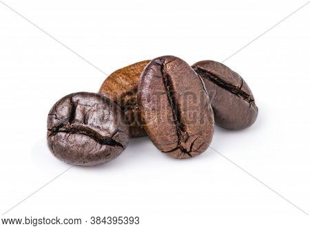 Two Fresh Roasted Dark Brown Arabica Coffee Beans Isolated On A White Background With Clipping Path.