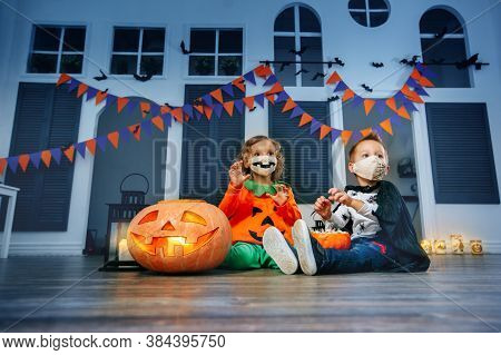 Children's Trick Or Treat In A Halloween Costume And Face Masks At The Autumn Fun Festival Indoor.