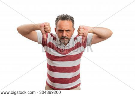 Adult Male Model With Angry Annoyed Expression Making Double Thumbs-down Dislike Disapprove Gesture