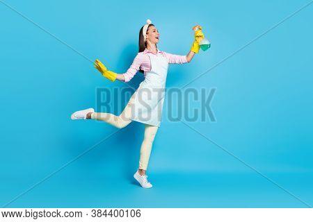 Full Length Profile Side Photo Of Positive Cheerful Girl Hold Sprayer Bottle Spray Copyspace Disinfe