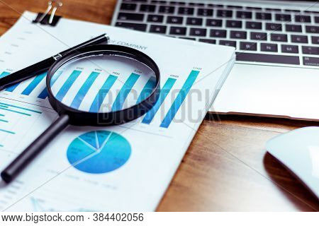 Charts And Graphs Are Placed On The Desks, Data, And Statistical Performance Of The Company In The P