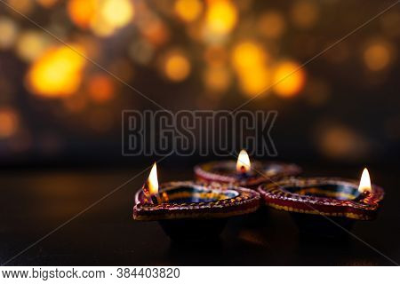Indian Festival Diwali, Diya Oil Lamps Lit On Colorful Rangoli. Hindu Traditional. Happy Deepavali.