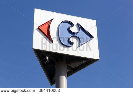 Creches, France - March 15, 2020: Carrefour Sign On A Pole. Carrefour Is A French Multinational Reta