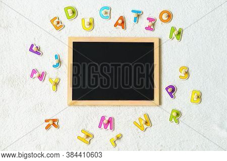 School Board. The Child Draws On The Board With Chalk. Preparing For School. Education For The Young