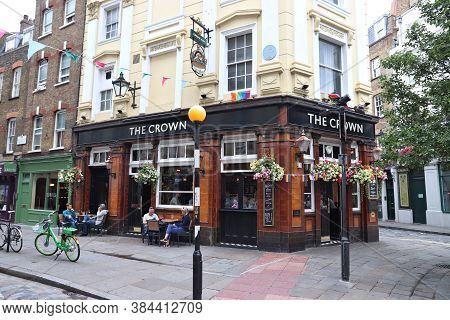 London, Uk - July 14, 2019: People Visit The Crown Pub In Soho Area Of London. It Is A Typical Londo