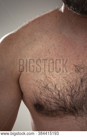 An image of a males hairy chest detail
