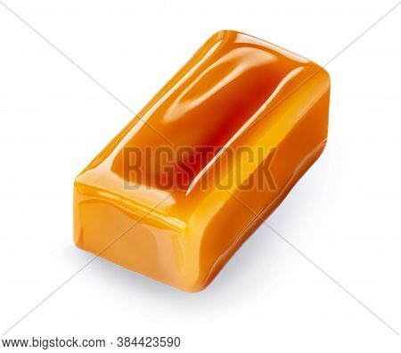 Soft Homemade Salted Caramel Piece Isolated On White Background. Golden Butterscotch Toffee Candy Ca