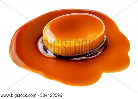 Caramel Round Candy And Caramel Sauce Isolated On A White Background. Macro
