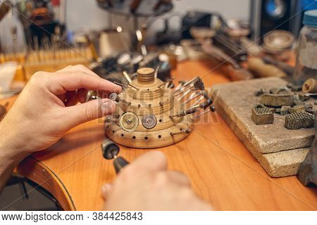 Young Caucasian Craftsman Working At The Workbench