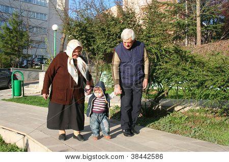 grandfather,grandmotherand grand son at kindergaden