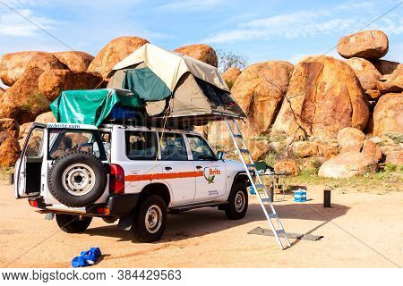 Wauchope, Australia - December 28, 2008: Off-road Car With Roof Top Tent Standing Near Devils Marble