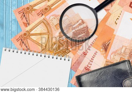 5 Belorussian Rubles Bills And Magnifying Glass With Black Purse And Notepad. Concept Of Counterfeit