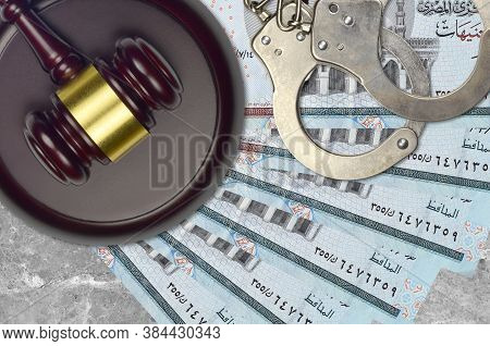 5 Egyptian Pounds Bills And Judge Hammer With Police Handcuffs On Court Desk. Concept Of Judicial Tr