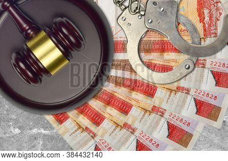3 Cuban Pesos Convertibles Bills And Judge Hammer With Police Handcuffs On Court Desk. Concept Of Ju