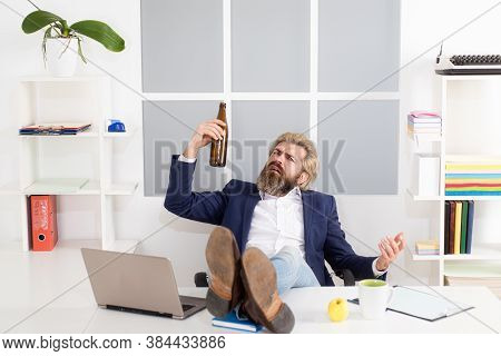 Businessman Drinking From Stress. End Of The Working Day. Depressed Businessman Has Problem At Work,