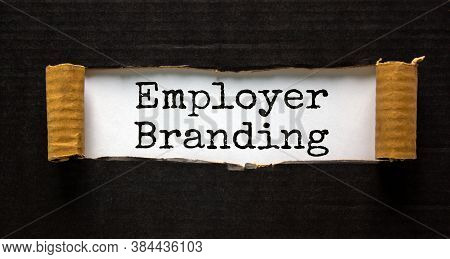 The Words 'employer Branding' Appearing Behind Torn Black Paper. Beautiful Background. Business Conc