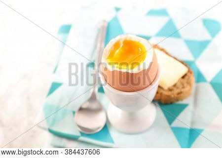 soft boiled egg with bread and butter
