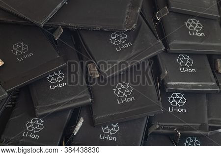 Close Up Of Old Used Lithium Polymer Batteries Of Mobile Phones Preparation For Recycling.