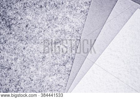 Close Up Of Pieces Of Felt Of Different Shades Of Grey From Dark To Very Light. Gray Spectrum. Copy