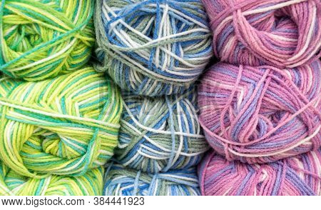 Close-up Of Skeins Of Motley Threads Mixed Pastel Colors Of White, Blue, Yellow, Green Ang Pink. Thr