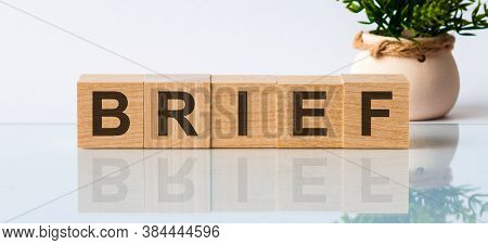 Brief - Words From Wooden Blocks With Letters, White Background