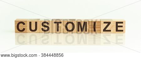 Word Customize On Wooden Cubes On White Background