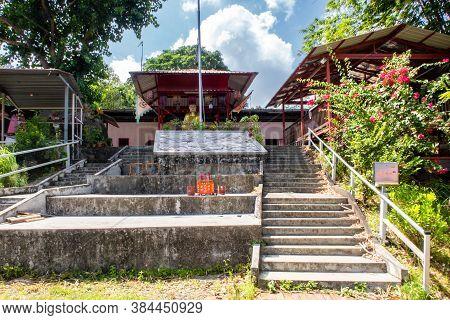 Buddhist Altar (butsudan) With Golden Buddha Statue In Wei Tuo Fa Gong Buddhist Temple In Pulau Ubin
