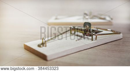 Mousetraps Without Bait On A Wooden Table, As A Business Concept
