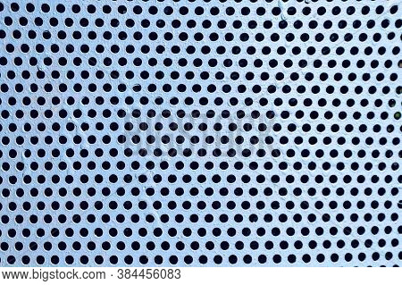 View Of Metal Grilles And Round Holes On The Surface Of Perforated Panels. Perforated Grid Texture W