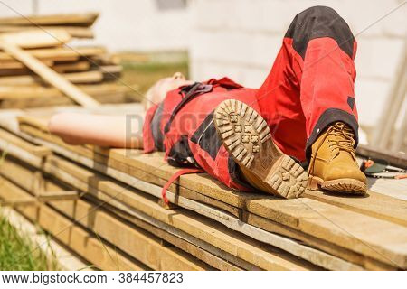 Unrecognizable Person On Construction Site Wearing Protective Worker Red Black Pants Trousers, Sole
