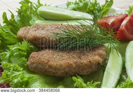 Pportion Of Potato Cutlets On A Plate With Vegetables (cucumber, Tomato) And Greens (lettuce, Dill).