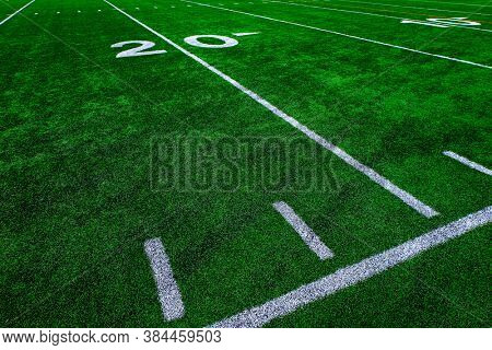Football field green grass white yard markers to touchdown competition game