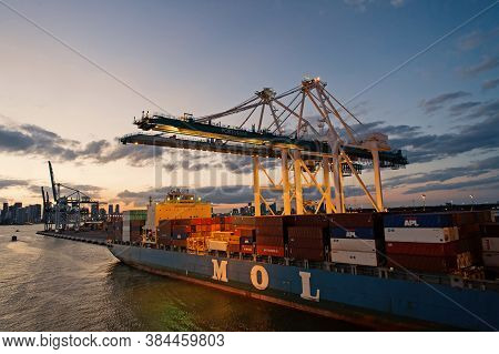 Miami, Usa - March 01, 2016: Container Ship Mol. Freight Ship In Evening Port. Ship And Cranes On Du