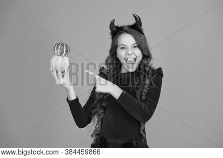 Very Spooky. Happy Girl Point Finger At Pumpkins Orange Background. Small Child With Spooky Hallowee