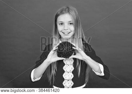 Child Hold Shimmering Decor Ball. Festive Decor Concept. Beautiful Decor. Christmas Party. Winter Ho