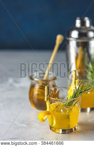 Two Glasses Of Honey Bourbon Cocktail With Rosemary Simple Syrup Or Homemade Whiskey Sour Cocktail D